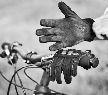 Mountain biking gloves pictured being worn