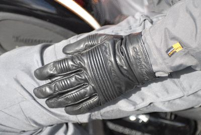 Olympia Motorcycle Glove on a rider's hand in use.